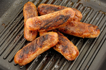 Fried Pork Sausages In A Griddle Frying Pan