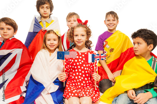 Children with flags wrapped in different banners stock photo and children with flags wrapped in different banners m4hsunfo