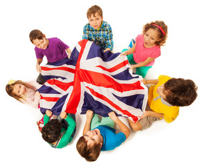 Kids with English flag in a middle of their circle