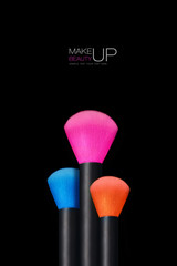 Makeup concept. Colorful Make up brushes over black background