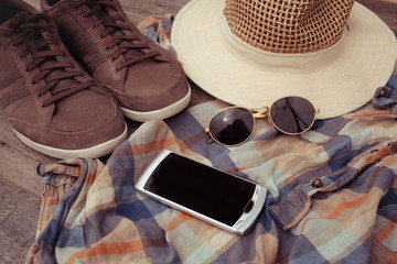 Clothing accessories, blue shirts, hat and sneakers , smartphone