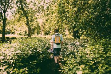 Caucasian man hiking in lush park