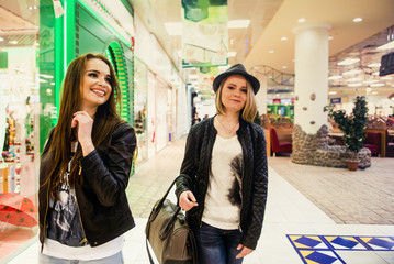 Caucasian women walking in shopping mall
