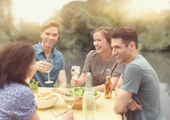 Friends having dinner party in backyard