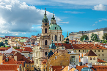 Wall Murals Prague St. Nicolas church and and roofs of Prague