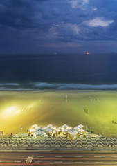 Aerial view of beach under cloudy sky