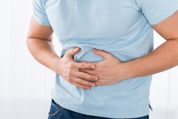 Man Suffering From Stomach Ache