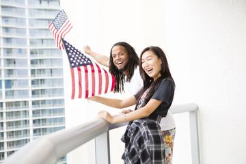 Happy couple waving American flag