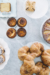Overhead view of variety of pastries on counter