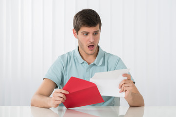 Surprised Man Looking At Letter