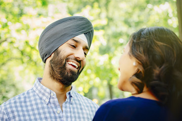 Indian couple talking in urban park