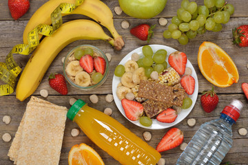 Fruits and cereals on a wooden background