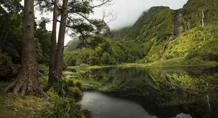 Green landscape with still river, Azores