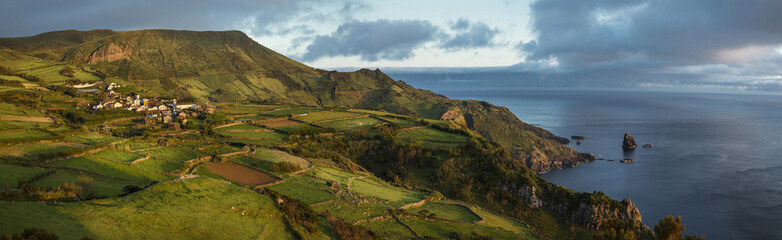 Aerial view of rural fields at coastline, Azores