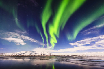 Northern lights reflecting in still remote river