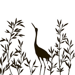 heron in thicket of bamboo branches with leaves