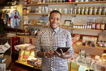 Woman using digital tablet in store