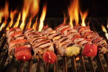 Many Shish Kebab On The BBQ Flaming Charcoal Grill