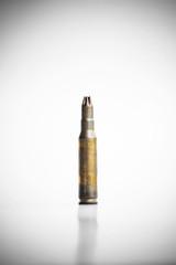 Old machine gun bullet