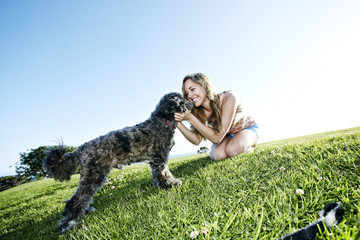 Caucasian woman playing with dog