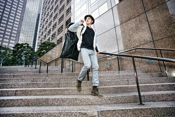 Caucasian businessman walking on steps