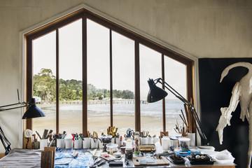 Window and desk in studio of artist