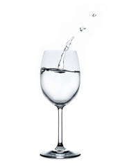 splashing water wave in the wine glass