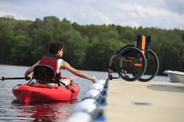 Caucasian paraplegic woman rowing kayak