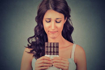 young woman tired of diet restrictions craving sweets chocolate