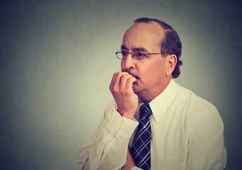 Side profile preoccupied anxious concerned middle aged business man in glasses