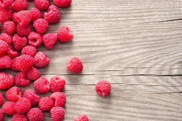 Sweet raspberries on wooden background. Close up, top view, high resolution product. Harvest Concept