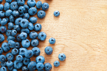 Healthy blueberries on wooden background. Close up, top view, high resolution product. Harvest Concept