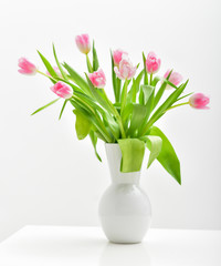 Bright spring bouquet in a vase. Springtime. Vase with tulips.