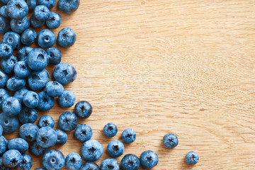 Premium Blueberries on wooden background. Close up, top view, high resolution product. Harvest Concept