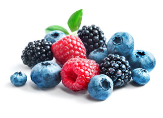 Blueberries, raspberries and blackberries on white background. Close up, high resolution product. Harvest Concept