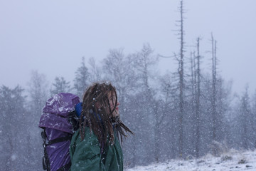 Caucasian hiker walking in snow