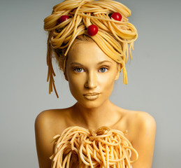 Portrait of a woman with a lot of pasta on head. Pasta with toma