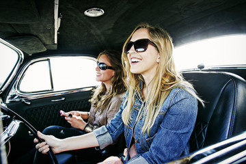 Women driving vintage car