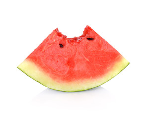 watermelon slice with a bite taken out  on white background