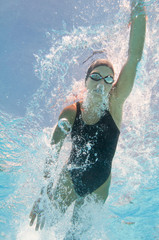 Water sports. Underwater image of competitive swimmer