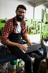 Bike mechanic using laptop