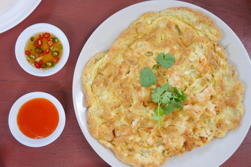 deep fried shrimp omelet with exotic dip sauce, top view