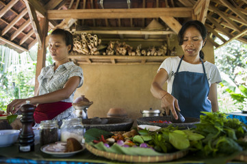 Asian chefs cooking in outdoor kitchen
