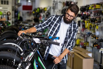 Bike mechanic checking bicycles