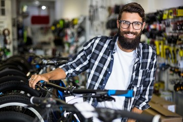 Bike mechanic checking bicycles