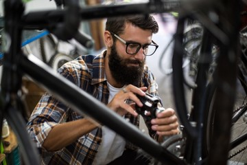 Bike mechanic checking at bicycle