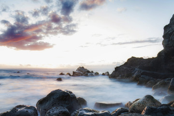 Wall Mural - Long exposure of rocky coastline at dusk golden hour