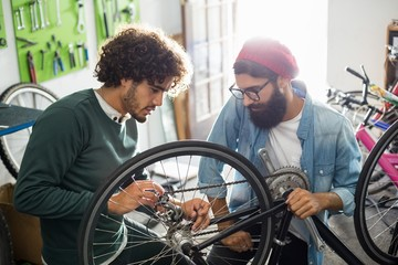 Bike mechanic talking to customer about the repairs