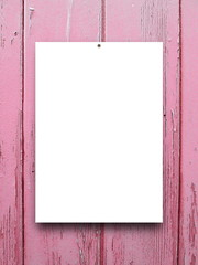 Close-up of one nailed blank frame on pink weathered wooden boards background