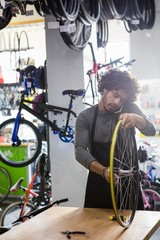 Worker repairing bicycles